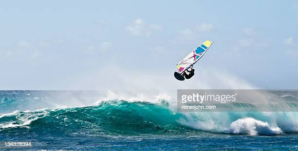 Windsurfer flying over wave