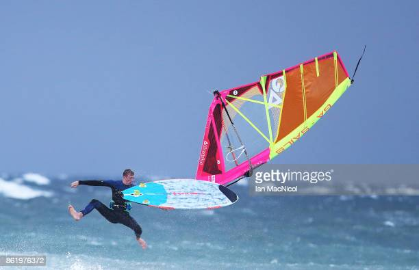 A windsurfer is seen competing during the running of the 31st Tiree Wave Classic at Crossapol Bay on October 16 2017 in Tiree Scotland