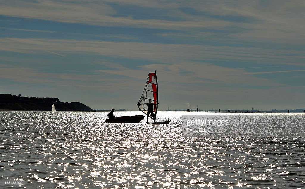 A windsurfer receives instruction during a lesson at West Kirby Marine Lake near Liverpool, northwest England, on October 06, 2013.