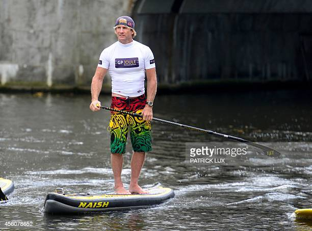 US windsurfer world champion Robby Naish takes part to a stand up paddle boarding tour on the Alster river in Hamburg on September 25 2014 Robby...