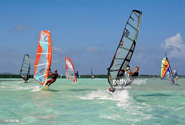 Windsurfers enjoy the waters of Lac Bay on February 7 2011 on Bonaire Netherlands Antilles Bonaire with its shallow waters is an ideal place to learn...