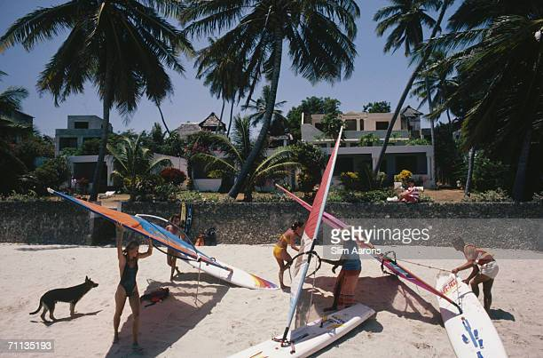 Windsurfers on the beach of the Peponi Hotel on Lamu Island in the Lamu Archipelago of Kenya February 1987
