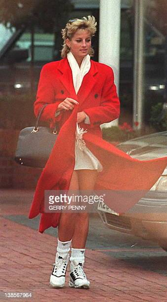A windswept Princess Diana leaves her London health club after her morning workout 24 January the day after a second member of her household staff...
