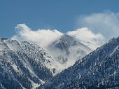 A mountain peak covered with snow in the winter.