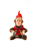 Wind-up toy monkey with cymbals on white background