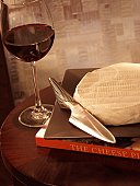 Wine and cheese on a side table.