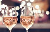 Wine glasses against bokeh background. New Year's celebration.