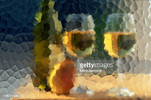 Wine and glasses behind frosted glass : Stock Photo