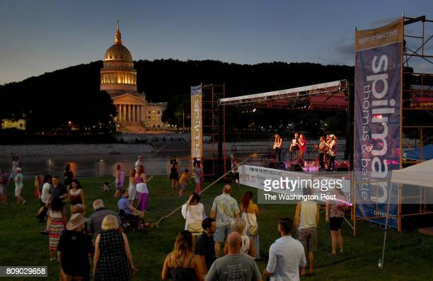Wine and music fans danced and enjoyed the sounds of The High Mighty Brass Band at the Wine All That Jazz Festival on the banks of the Kanawha River...