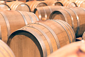 Wine background with wine barrels cellar of the winery