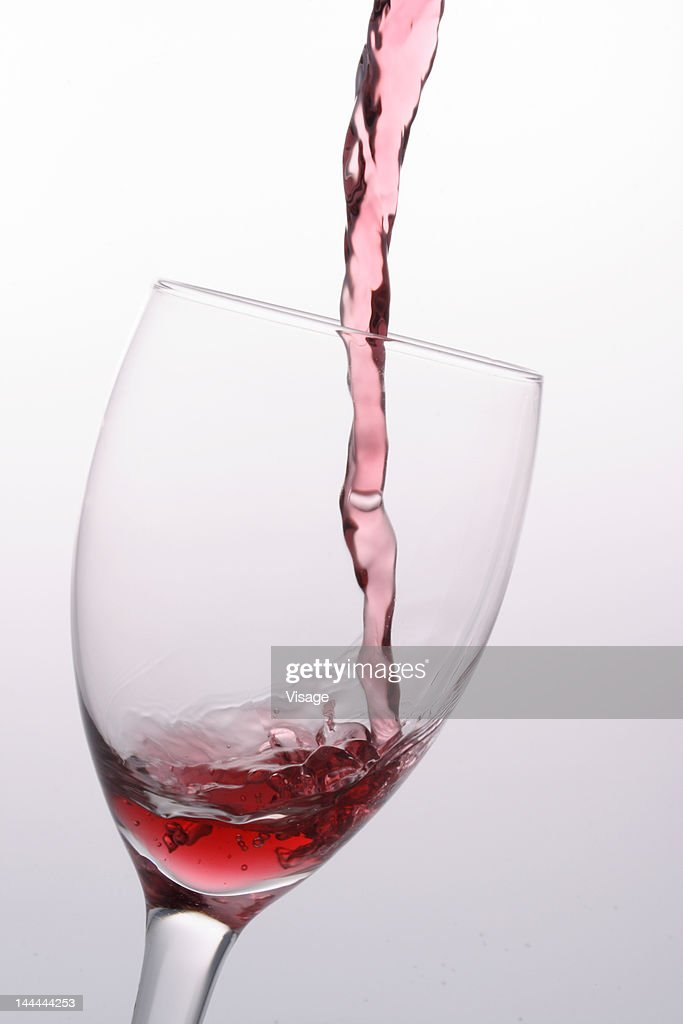 Wine being poured into a glass : Stock Photo