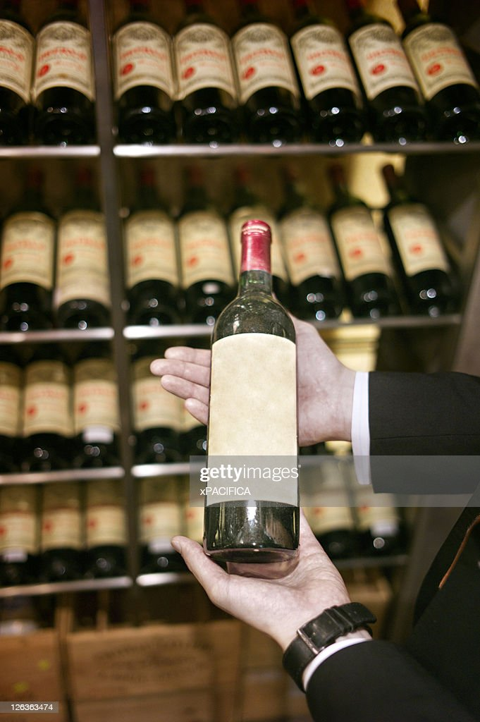 A wine bottle being presented : Stock Photo