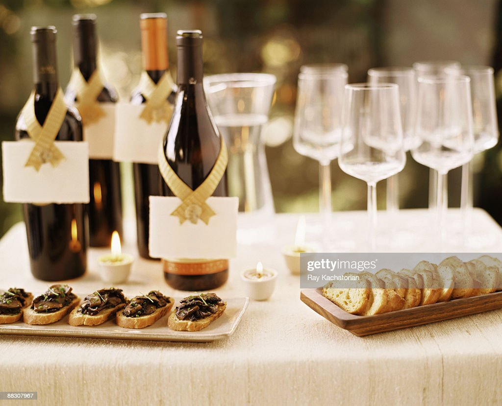 Wine bottles and canapes stock photo getty images for Canape wines