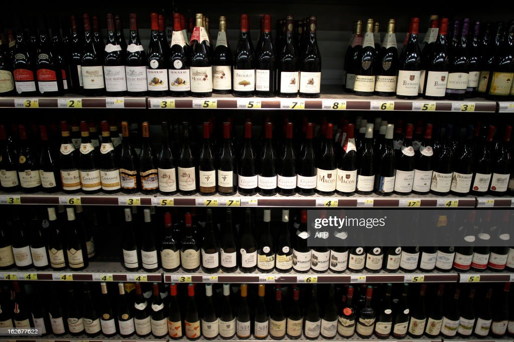 Wine bottles are displayed at a supermarket in Herouville Saint-Clair, northwestern France, on February 26, 2013. AFP PHOTO/CHARLY TRIBALLEAU.