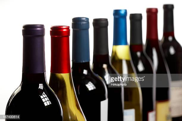 Wine bottles in a row on white horizontal