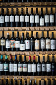 Different kinds of wine bottles on shelves at a winery