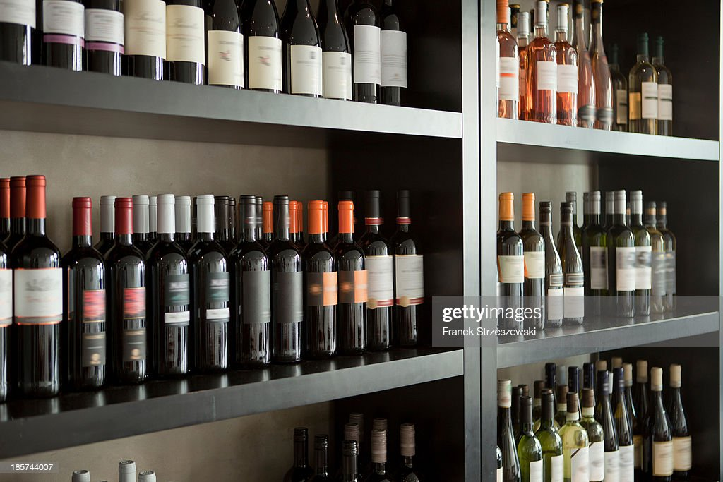 Wine bottles on shelves : Stock Photo
