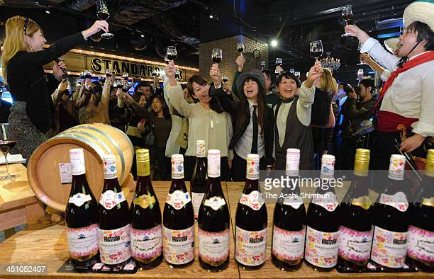 Wine connoisseurs toast the midnight release of the 2013 Beaujolais Nouveau vintage at a restaurant on November 21 2013 in Osaka Japan The guests...