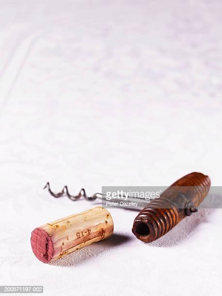 Wine cork and corkscrew, studio shot