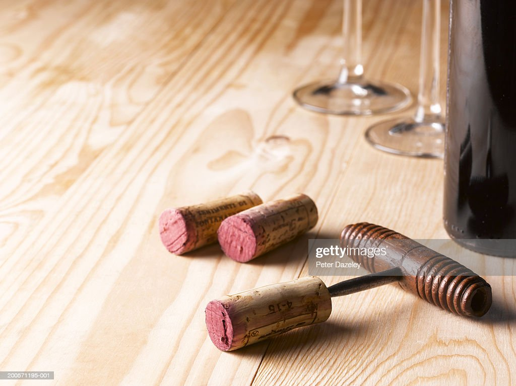 Wine Corks And Corkscrew With Bottle And Glasses On Wooden Table : Stock  Photo