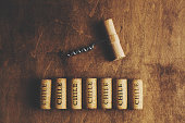 """Wine corks in a row with corkscrew above the corks.  The inscription """"Chile"""" on the wine corks. Chilean wine concept."""