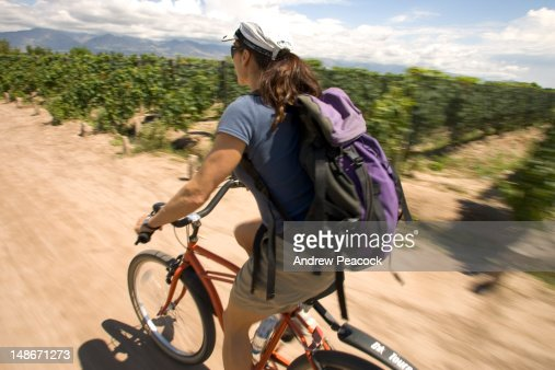 A wine cycling tour particapant on her bike.