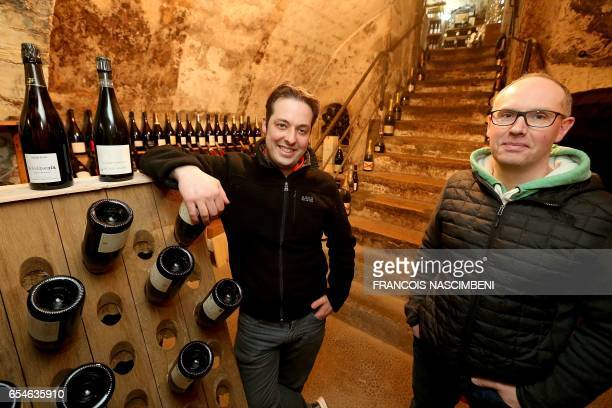 Wine dealers Cédric Pilot and Fabrice Parisot pose in their business 'la cave du forum' in Reims on March 10 2017 In the shadow of the big names of...