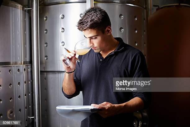 Wine expert smelling white wine samples