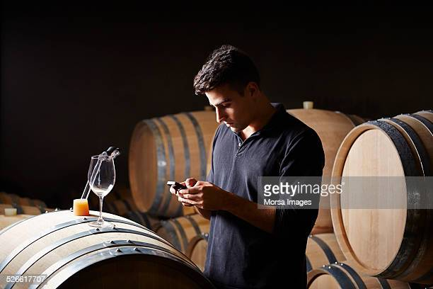 Wine expert taking notes on a smartphone