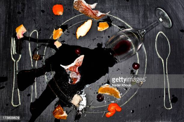Wine glass and food spilled onto chalkboard