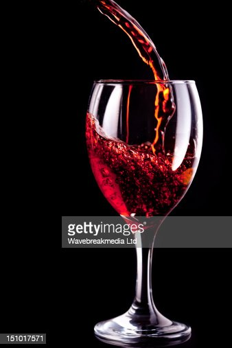 Wine glass being filled : Stock Photo