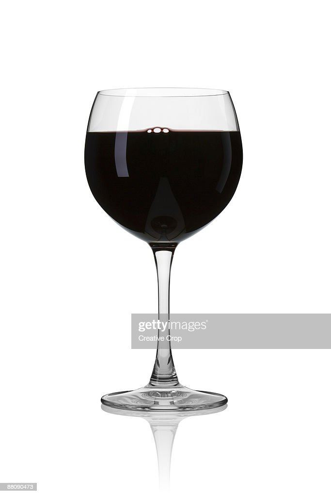 Wine glass containing red wine : Stock Photo