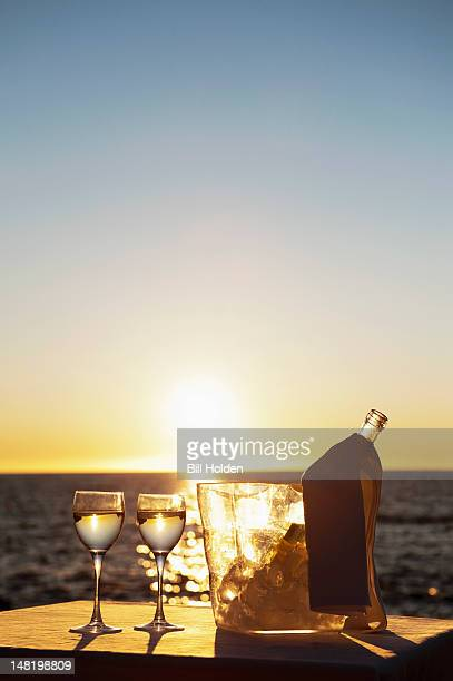 Wine glasses and bottle outdoors