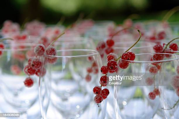 Wine glasses decorated with frosted red currants