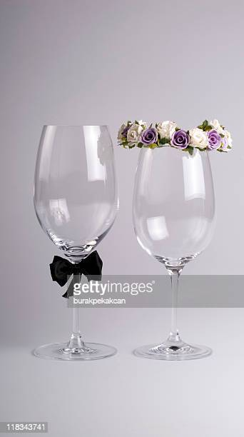 Wine glasses dressed as bride and groom
