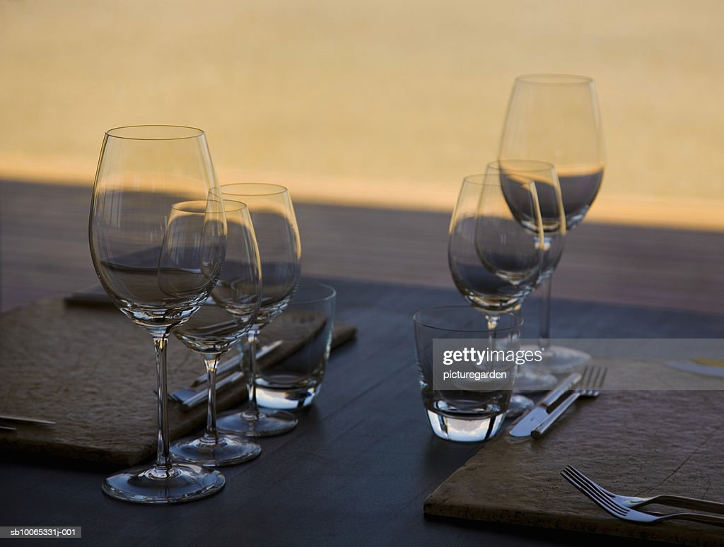 Wine glasses on table with fork and knifes : Stock Photo