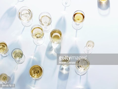 Wine glasses with white wine on white tablecloth : Stock Photo