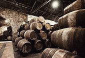 Old wooden barrels in wine cellar. Porto, Portugal