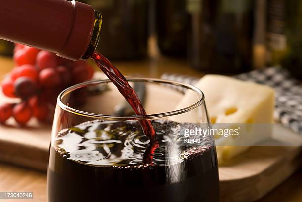 Wine pour with cheese and grapes