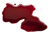 Wine red puddle poured over white background