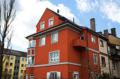 wine red multi-family house in Germany,