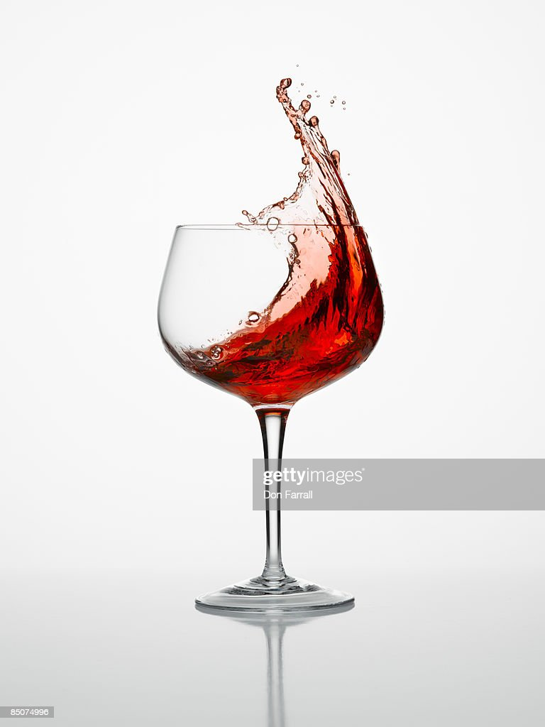 Wine splash in a glass : Stock Photo