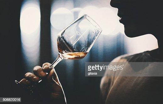 Wine tasting in wine cellar.
