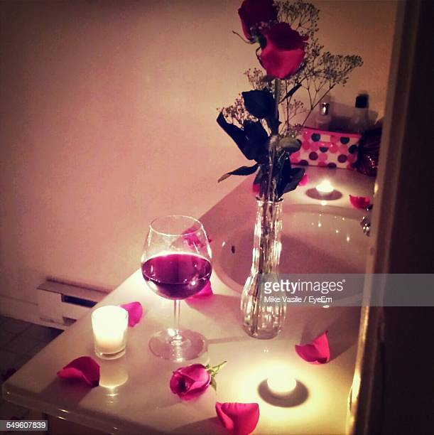 Wineglass And Rose In Vase