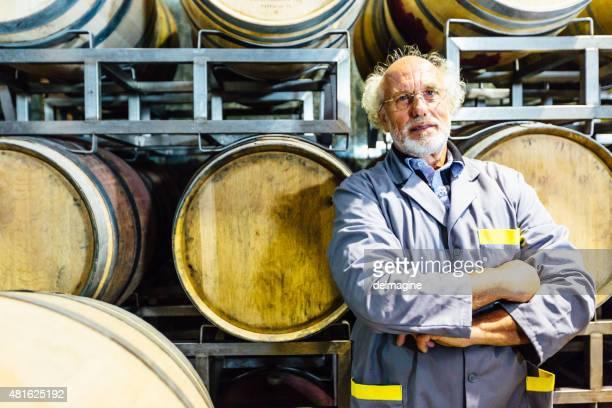 Winemaker man with his wine barrels