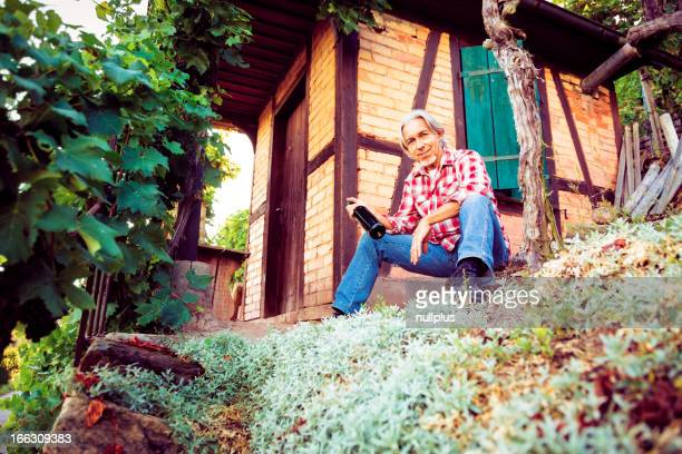 winemaker sitting by his cottage