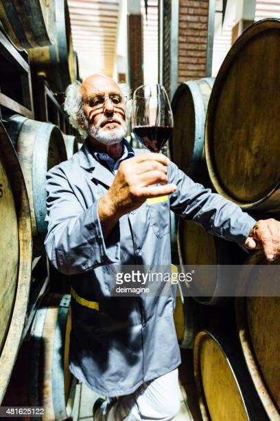 Winemaker tasting red wine