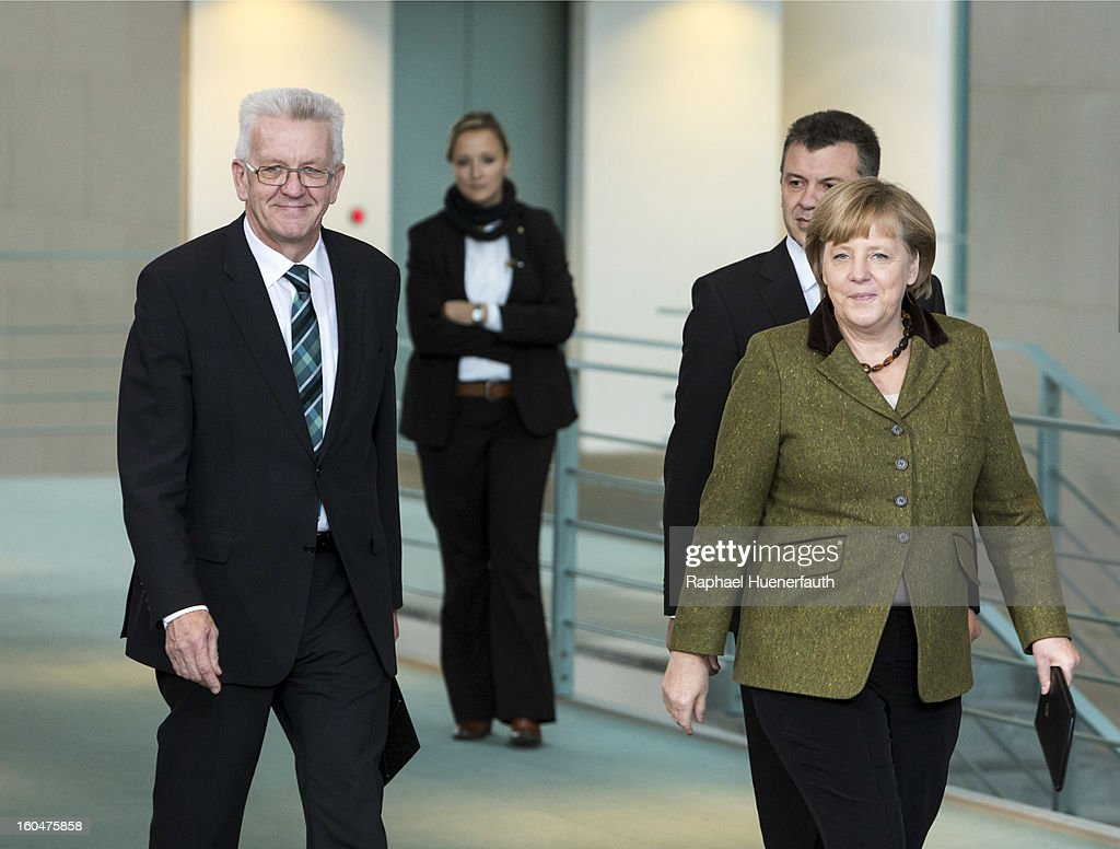 Winfried Kretschmann (L), Minister-president of Baden-Wuerttemberg and German Chancellor Angela Merkel (R) arrive at the Federal Chancellery for the presentation of the new Baden-Wuerttemberg 2 Euro coin, on February 01, 2013 in Berlin, Germany. Germany began issuing 2--euro commemorative coins in 2006, with each devoted to a federal state.