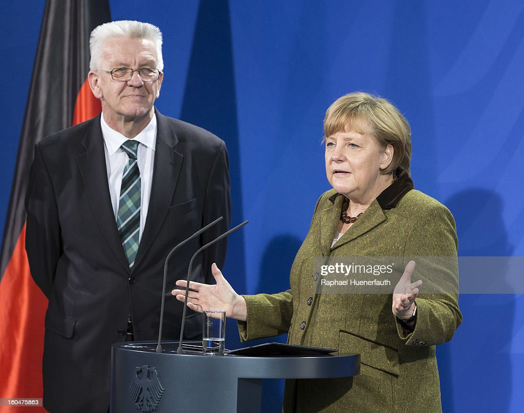 Winfried Kretschmann (L), Minister-president of Baden-Wuerttemberg and German Chancellor Angela Merkel (R) arrives at the Federal Chancellery for the presentation of the new Baden-Wuerttemberg 2 Euro coin, on February 01, 2013 in Berlin, Germany. Germany began issuing 2--euro commemorative coins in 2006, with each devoted to a federal state..