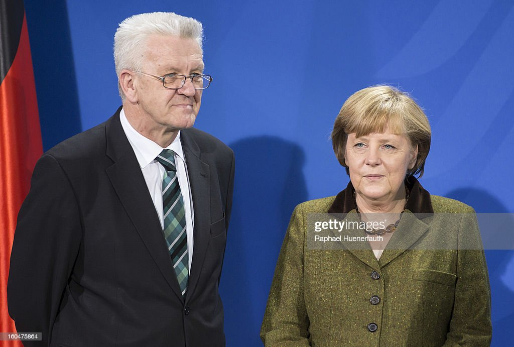 Winfried Kretschmann (L), Minister-president of Baden-Wuerttemberg and German Chancellor Angela Merkel (R) arrives at the Federal Chancellery for the presentation of the new Baden-Wuerttemberg 2 Euro coin, on February 01, 2013 in Berlin, Germany. Germany began issuing 2--euro commemorative coins in 2006, with each devoted to a federal state.